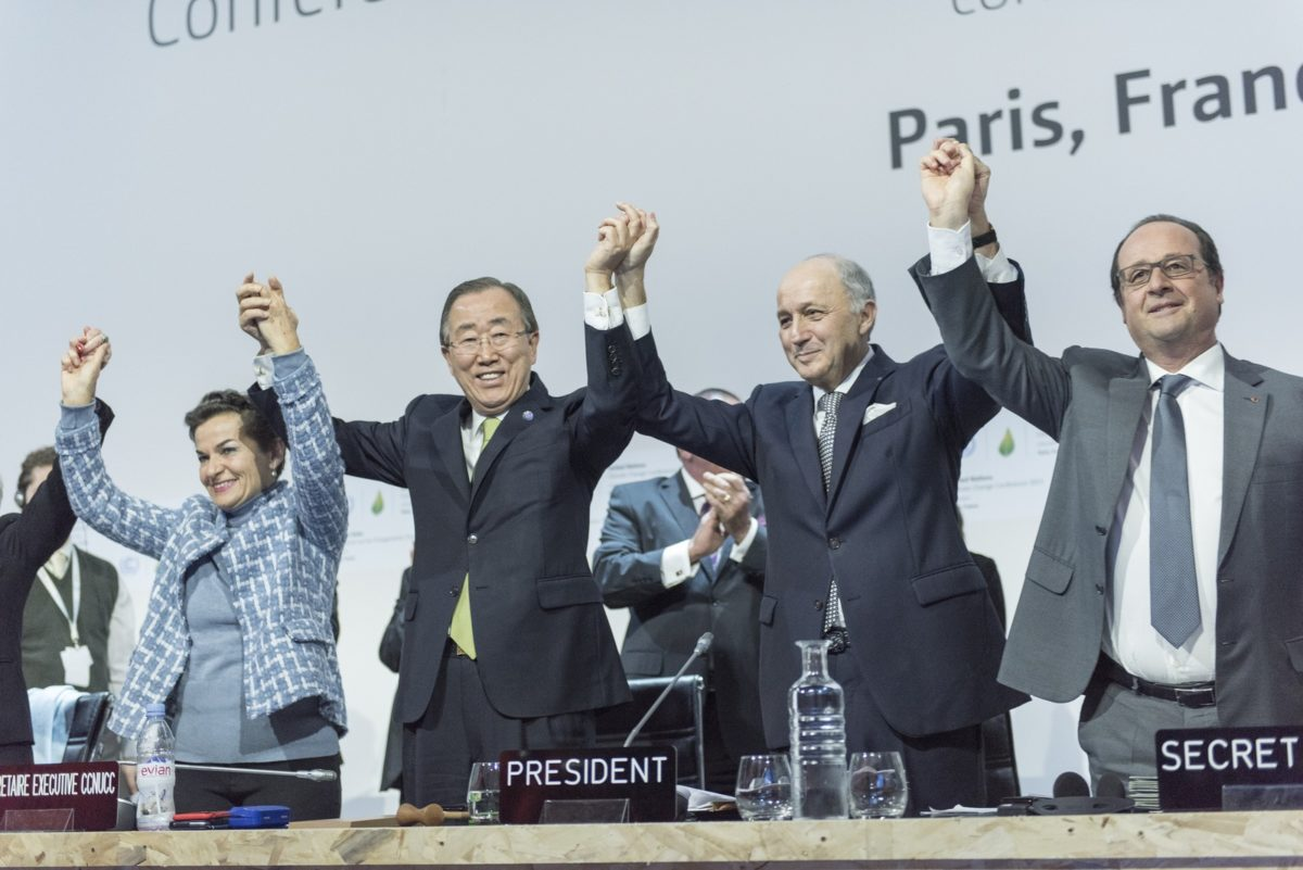 United Nations Secretary-General Ban Ki-moon (second left) and others celebrate after the historic adoption of Paris Agreement on climate change.