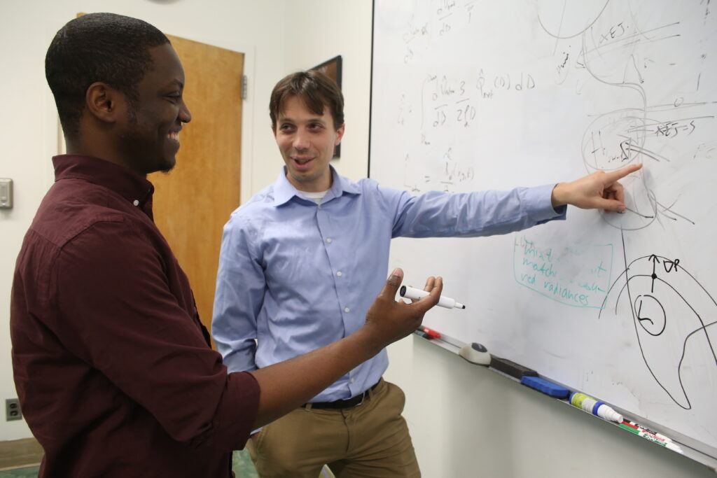 Postdoctoral scientist Adeyemi Adebiyi and Jasper Kok, associate professor of atmospheric and oceanic sciences.