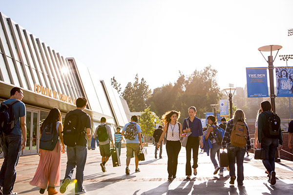 Students on Bruin Walk pass the north entrance to Pauley Pavilion. Photo by Coral Von Zumwalt