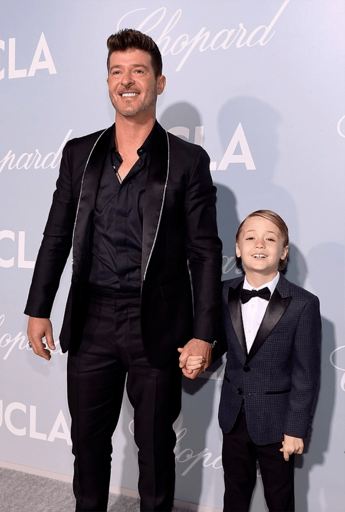 daily mail: robin thicke and son julian look sharp in suits as they attend the hollywood for science gala