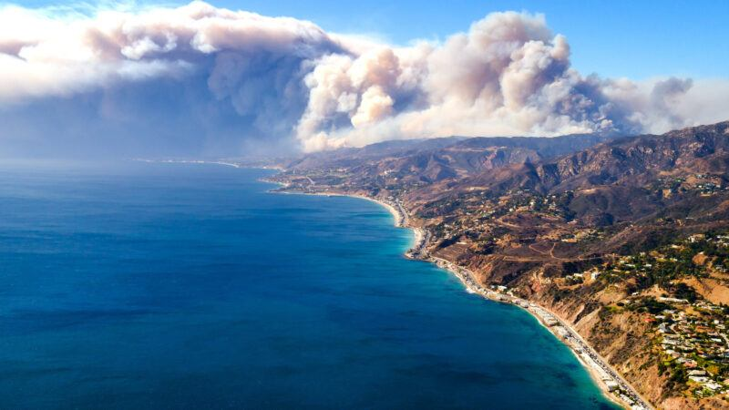 The Woolsey Fire smoke plume looms over Malibu's iconic coastline.